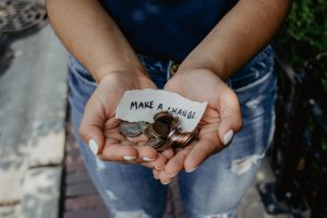 Womans hand full of coins