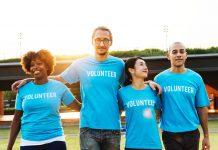 Four people wearing blue Volunteer T-shirts