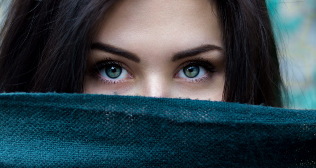 Green eyes of a young woman