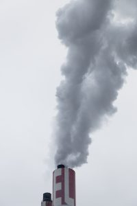 Factory smokes from chimneys