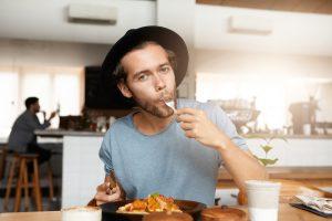 Adult man having meal