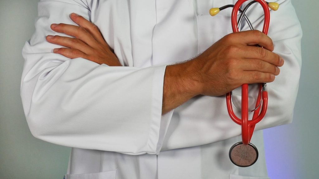 Doctor holding stethoscope in his hand