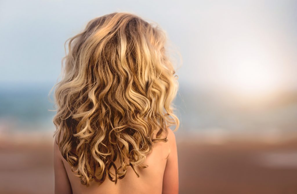 Curly blond woman