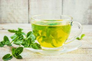Green tea contains caffeine burning of fat, rich in catechins antioxidant promoting weight loss. Mint faster metabolism stimulates digestive enzymes better absorption of nutrients in food.