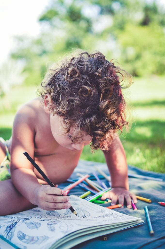 Baby painting outdoors
