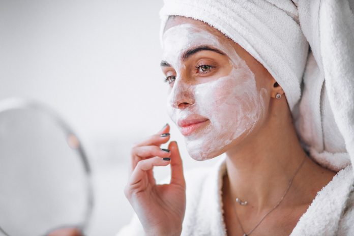 Woman applying beauty mask