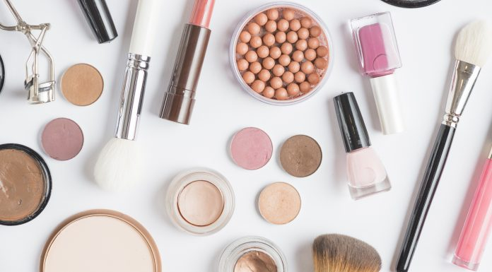 Cosmetics and brushes on a white background