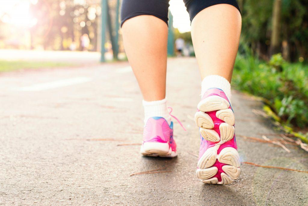 Woman's legs in pink fitness footwear