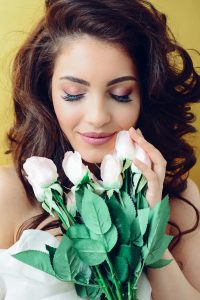 Attractive woman holding flowers
