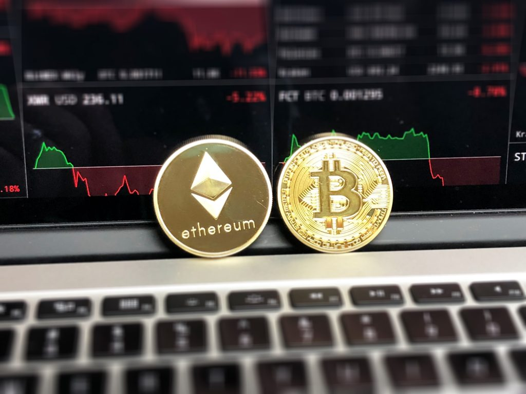 Bitcoin blockchain, two coins resting on a laptop