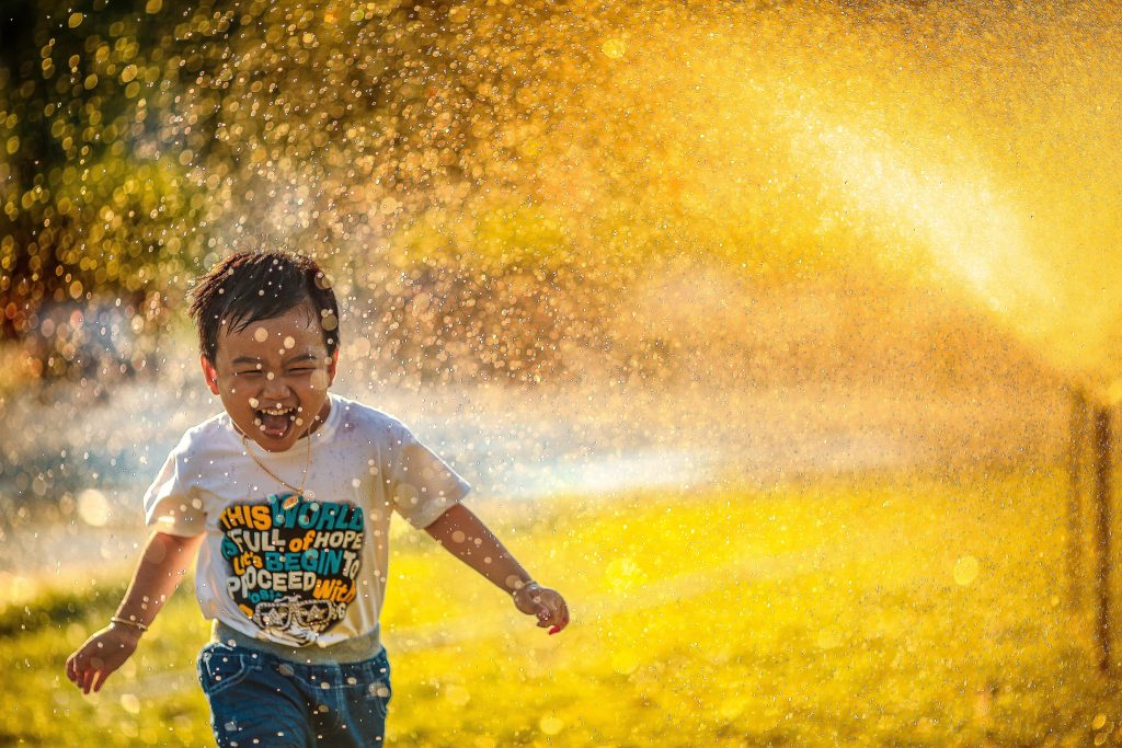 Happy little boy running during daytime