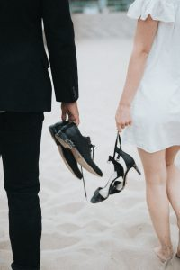 Couple carrying their shoes