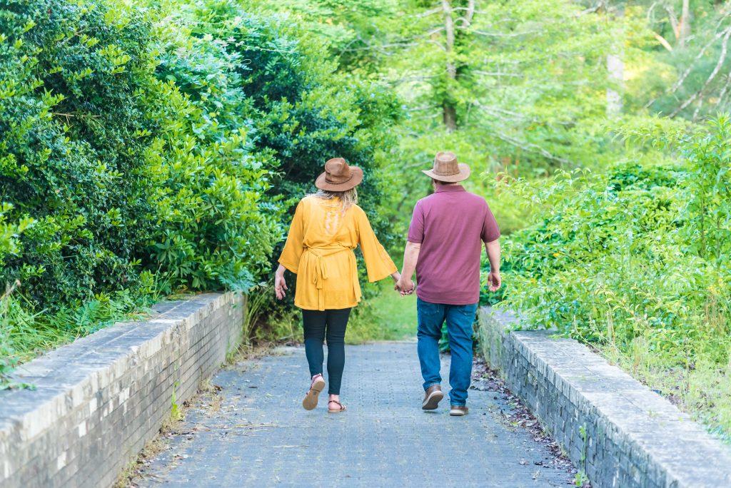 couple walking in the park, regular strolls, benefits for health, healthy lifestyle, fresh air strolls,